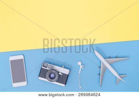 Hi Tech Travel Gadget And Accessories On Blue Yellow Copy Space Flat Lay Top View