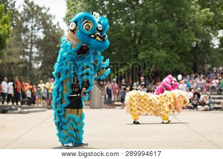 Columbus, Ohio, USA - May 27, 2018  Members of the Tay Phuong Monastery perform a lion dance at the Asian Festival.