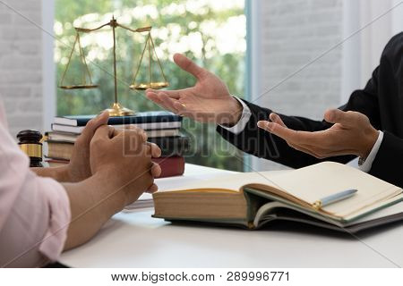 Concepts Of Law, Lawyer And Businessman Discussing Contract And Business Papers.
