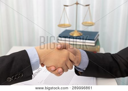 Concepts Of Law, Lawyer And Businessman Shaking Hands In Office After Discussing Contract And Busine