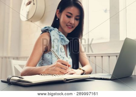 Freelancer Business Woman Working In Cafe With Tablet On Table.