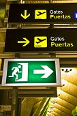 Gate and exit sign panels in airport, Madrid. poster