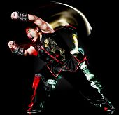 whushu chinese boxing kung fu Hung Gar fighter isolated man isolated on black background with speed light painting effect motion blur poster