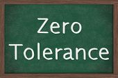 A chalkboard with the chalk letters zero tolerance Zero Tolerance Policy at schools poster