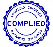 Grunge blue complied word round rubber seal stamp on white background poster