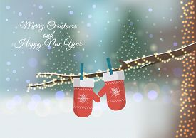 Christmas Greeting Card With Mittens On The Blurred Background. Red Knitted Mittens On The Branch. C