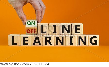 Time To Online Learning. Male Hand Turns The Cube And Changes The Expression 'offline Learning' To '