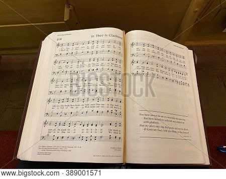 A Hymnal Openned Up The Hymn For The Sunday Services.