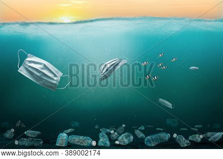 Ocean Full Of Medical Masks And Plastic Trash Contributing To Marine Pollution Problem. Surgical Mas