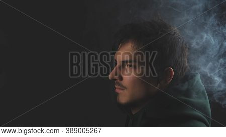 Young Man On The Black Background. Male Portrait