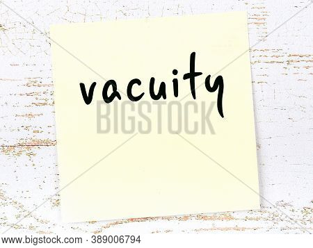 Concept Of Reminder About Vacuity. Yellow Sticky Sheet Of Paper On Wooden Wall With Inscription