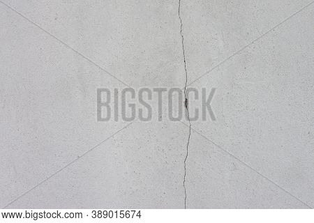 Cement Wall Of The House With Cracks  For Background And Textures.