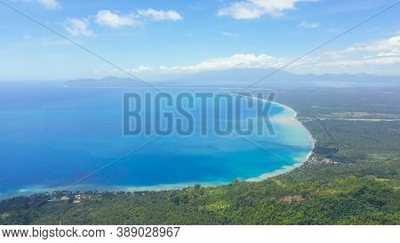 Mindanao Island Covered With Rainforest. Blue Sea And Beaches In The Philippines.