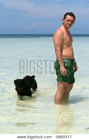 Man And Dog In Water
