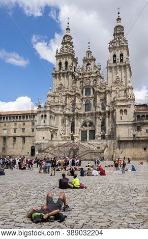 Santigo De Compostela, Spain - July 27: Pilgrim Lying Down Observes The Frontage Of The Cathedral Of