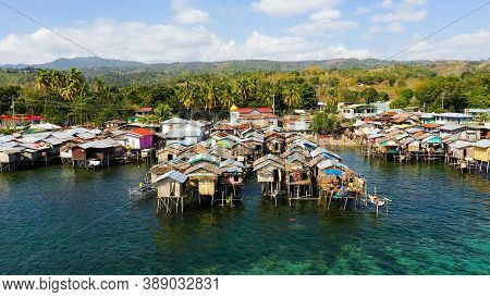 Fishing Village With Wooden Houses On Stilts In The Sea. Village Of Fishermen With Houses On The Wat