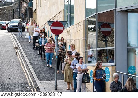 Derry, Northern Ireland- Sept 27, 2020: Long Queue Outside Primark Store In Derry Northern Ireland D