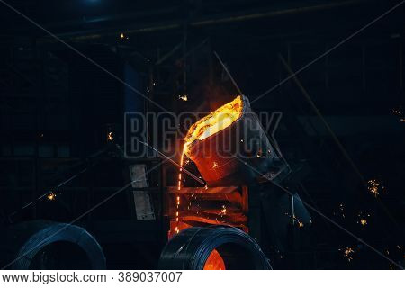 Metal Casting Process In Metallurgical Plant.liquid Metal Pouring Into Molds