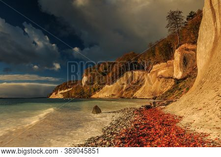 Chalk Cliffs In The Morning On The Island Of Ruegen. Coastline In Autumn At Sunrise With Sunshine. T
