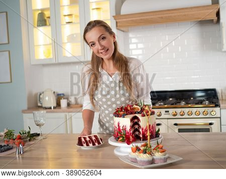 Pastry Chef In The Kitchen Makes Desserts, Cakes And Muffins. Cooking At Home. Delicious And Beautif