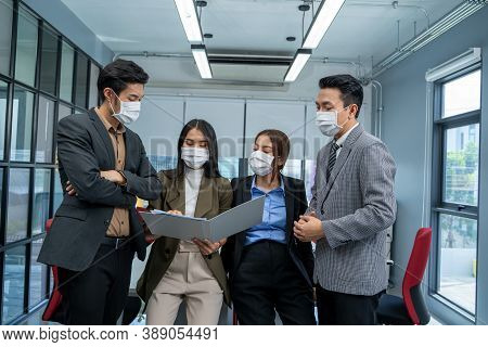 Group Of Businesspeople Team In Office Wearing Mask For Protect Corona Virus Disease Working Togethe