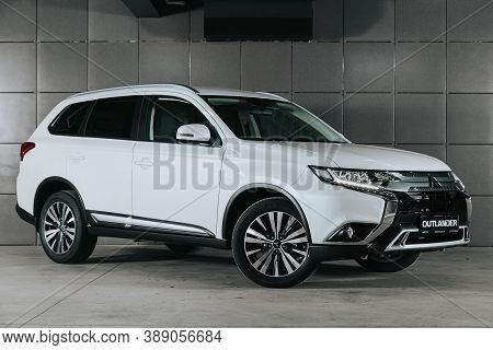 Novosibirsk, Russia - October 08, 2020: White Mitsubishi Outlander, Front View.  Photography Of A Mo