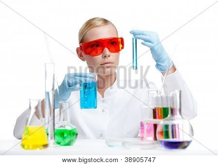 Female doctor in spectacles performs some experiments, isolated on white