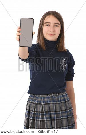 Pre-adolescent Girl Holding Black Smartphone With Blank Screen. Isolated On White Background. High R