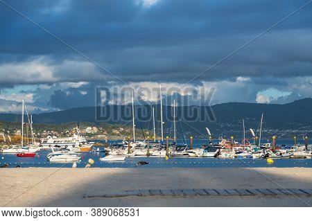 Portonovo, Spain - August 15, 2020: Wide-angle View Of The Yacht Club Of Portonovo Full Of Small Sai