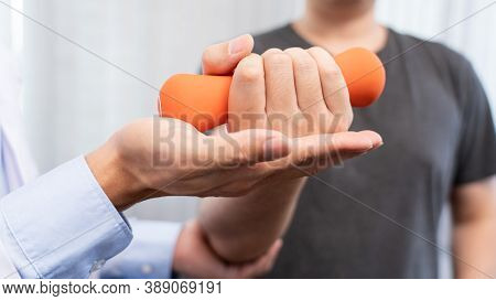 Physiotherapist Doctor Rehabilitation Consulting Physiotherapy Giving Dumbbell Exercising Treatment