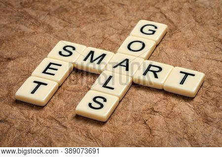 set SMART goals - crossword in ivory letters against textured paper, goal setting, business and personal development concept