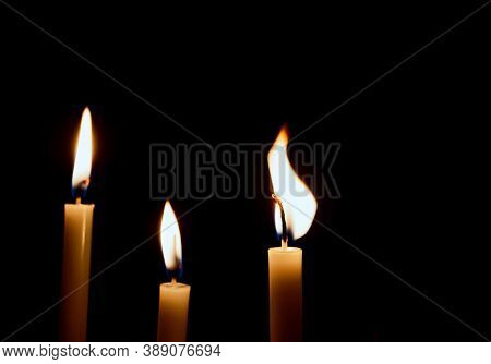 Lighting Candles, Burning Candle On Black Background, Candle In Hand, Candle In The Dark, Design For