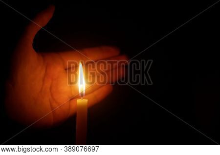 Someone's Hand Covering The Candle In A Dark Design For The Background, The Candle In The Dark Symbo