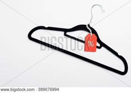 Black Friday Sale Banner. Coathanger With Red Tag On White Background. Special Offer, Discount In Cl