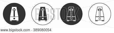 Black Classic Metronome With Pendulum In Motion Icon Isolated On White Background. Equipment Of Musi