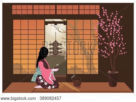 Woman In Kimono Conducts A Traditional Japanese Tea Ceremony. The Interiors Of The Room Overlooking