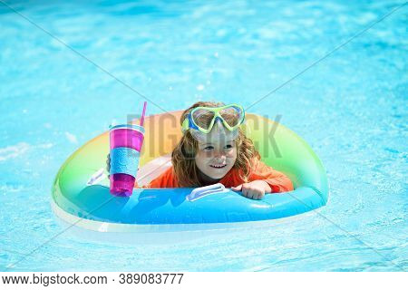 Child Swims And Dives In The Pool. Cute Funny Little Toddler Boy In A Colorful Swimming Suit Relaxin