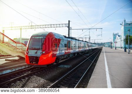 Modern High-speed Train On The Platform. Passenger Red Train At The Station Waiting.