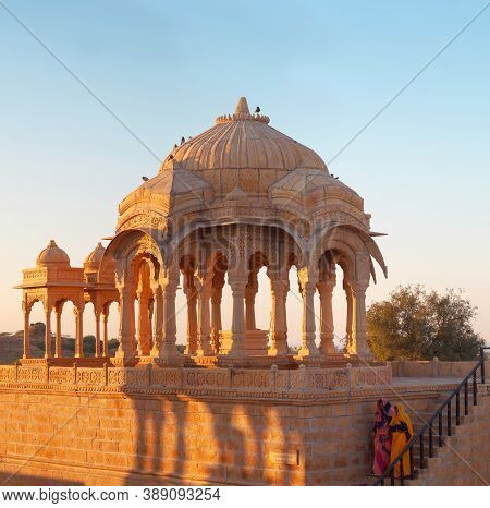 Jaisalmer, India - January 9, 2020 - Indian Tourists Walking In Ancient Bada Bagh Cenotaphs In Deser