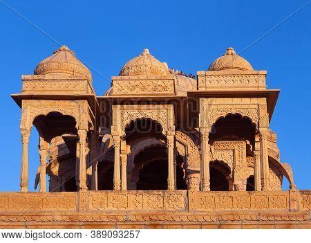 Ancient Bada Bagh Royal Cenotaphs, Also Known As Jaisalmer Chhatris At Sunset In Jaisalmer, Rajastha