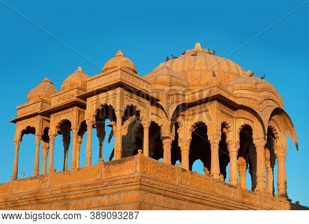 Ancient Bada Bagh Cenotaphs In Desert, Also Known As Jaisalmer Chhatris Made Of Yellow Sandstone At
