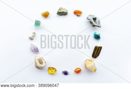 Bright Precious Minerals And Gemstones In The Form Of A Ring On A White Background. Precious And Sem