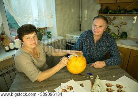 Making Jack O'lantern At Home. The Process Of Creating A Jack O'lantern Theme Template. A Man And A