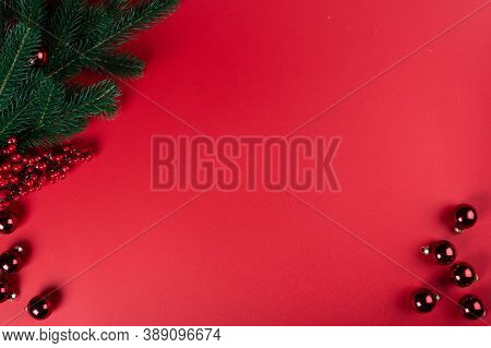 Christmas Composition. Christmas Red Decorations, Christmas Tree Branches On Red Background. Flat La