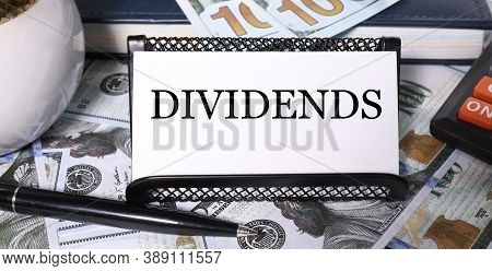 Dividends, Text On White Paper With Dereg Background