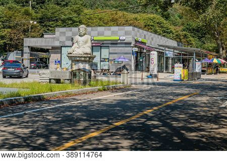 Jinan County, South Korea; September 20, 2020: For Editorial Use Only. Stone Carved Seated Buddha In