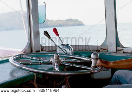 Steering Wheel Ship And Hand Of Boat Driver Inside The Boat, Steering Wheel Ship With Hand Holding,