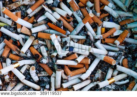 Cigarette Butts Top View, Lot Cigarette Butts And Burnt With Some Ash