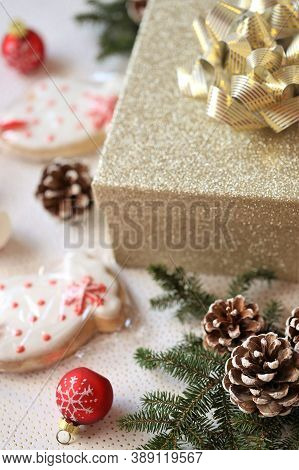 Christmas Presents.gift Box, Christmas Cookies, Red Balls, Fir Cones On A Light Background.surprises