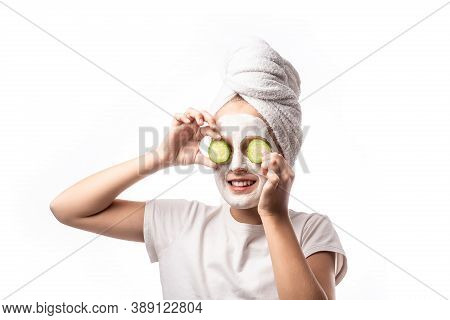 10 Years Old Preteen Chilling Making Clay Facial Mask Nd Cucumber Slices On Eyes. Teenage Girl Doing